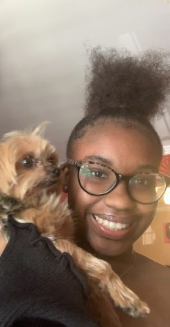 Samiyah McDuffie and her dog Pebbles together happily