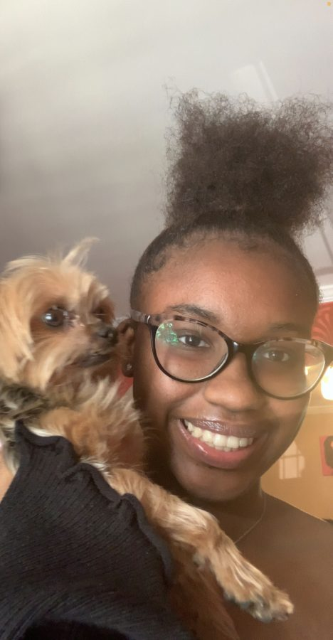 Samiyah+McDuffie+and+her+dog+Pebbles+together+happily
